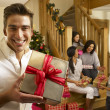 Hispanic family exchanging gifts at Christmas — Stock Photo #11882876