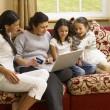 Hispanic family shopping online — Stock Photo