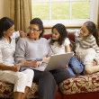 hispanic family shopping online — Stock Photo