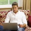 Young Hispanic couple shopping online — Stock Photo #11882900