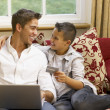 Hispanic father and son shopping online — Stock Photo
