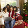 hispanic family christmas shopping online — Stock Photo #11882915
