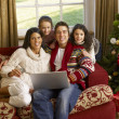Hispanic family Christmas shopping online — Stok fotoğraf