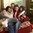 hispanic family christmas shopping online — Stock Photo