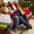 Young Hispanic couple resting after Christmas shopping — 图库照片