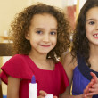 Young mixed race children doing handicrafts — Stock Photo