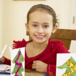 Young mixed race child making Christmas cards — Stock Photo #11882929