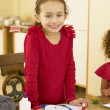 Young mixed race child making Christmas cards — Stock Photo