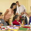 Stock Photo: Hispanic family making Christmas cards