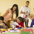 Hispanic family making Christmas cards — Stock Photo
