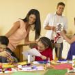 Hispanic family making Christmas cards — Stock Photo