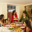 Stock Photo: Hispanic family serving Christmas dinner