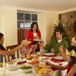 Foto Stock: Hispanic family having Christmas dinner