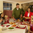 Hispanic family serving Christmas dinner — Stock Photo