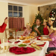 Stock Photo: Hispanic family taking photos of Christmas dinner