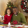 African American father and mixed race son making Christmas card — Stock Photo