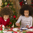 Mixed race children making Christmas cards — Foto Stock