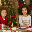 Mixed race children making Christmas cards — Stock fotografie
