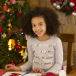 Mixed race child making Christmas cards — Stock Photo