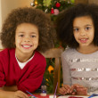 Mixed race children making Christmas cards — Stock Photo #11882952