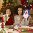 Stock Photo: Mixed race children making Christmas cards
