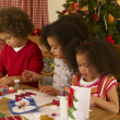 Mixed race children making Christmas cards — Stock Photo #11882955