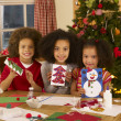 Mixed race children making Christmas cards — Stockfoto