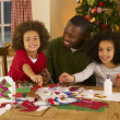 African American father making Christmas cards with children — Stock Photo