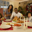 Mixed race family having Christmas dinner — Stock Photo #11882965