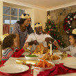 Mixed race family having Christmas dinner — Stock Photo