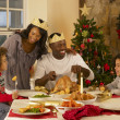 Mixed race family having Christmas dinner — Stock Photo #11882968