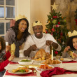 Mixed race family having Christmas dinner — Stockfoto