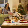 Adult African American family having Christmas dinner — Stock Photo #11882970
