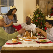 Adult African American family having Christmas dinner — Stock Photo #11882971