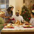 Adult African American family having Christmas dinner — Stock Photo #11882972
