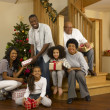 Mixed race family with Christmas tree and gifts — Foto Stock