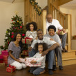 African American family with Christmas tree and gifts - Zdjęcie stockowe