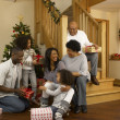 African American family exchanging Christmas gifts — Stock Photo