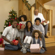 Stock Photo: Mixed race family with Christmas tree and gifts