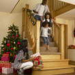 Stock Photo: Young African American family on Christmas morning