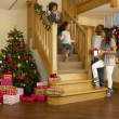 Young mixed race family on Christmas morning — ストック写真