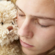 Close up teenage girl with cuddly toy — Stock Photo #11883034