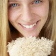 Close up teenage girl with cuddly toy — Stock Photo