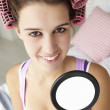 Teenage girl with hair in curlers — Stock Photo #11883052