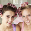 Teenage girls with hair in curlers — Stock Photo #11883056