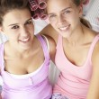 Teenage girls with hair in curlers — Stockfoto