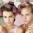 Teenage girls with hair in curlers — Photo