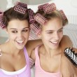 Teenage girls with hair in curlers — Stock Photo #11883067