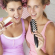 Teenage girls with hair in curlers — Stock Photo #11883069