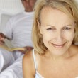Mid age couple in bedroom — Stock Photo #11883117